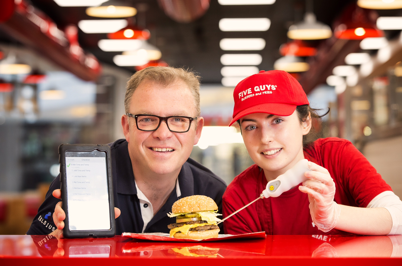 Paddy Hearty from Kelsius is pictured with Caroline Hutchinson from Five Guys.